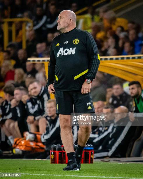 Assistant manager Mike Phelan of Manchester United watches from the touchline during the Premier League match between Wolverhampton Wanderers and...