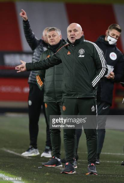 Assistant manager Mike Phelan of Manchester United watches from the touchline during the Premier League match between Sheffield United and Manchester...