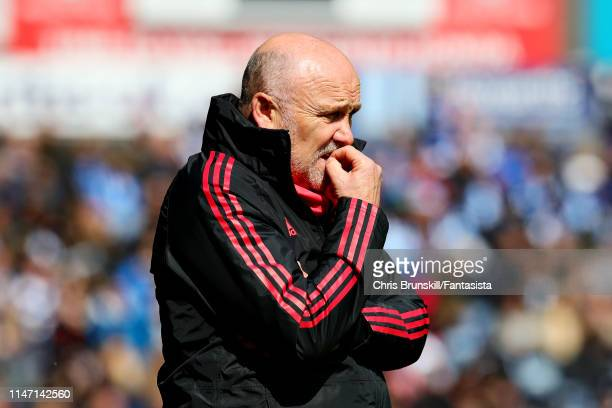 Assistant manager of Manchester United Mike Phelan looks on from the sidelines during the Premier League match between Huddersfield Town and...