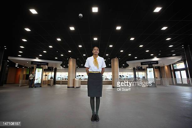 Assistant manager Rachel Lucien stands at the entrance to the world's largest McDonald's restaurant which is their flagship outlet in the Olympic...