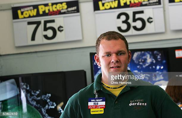 Assistant Manager Rob Myers stands for a portrait in the foyer of a WalMart Supercenter May 11 2005 in Troy Ohio WalMart America's largest retailer...