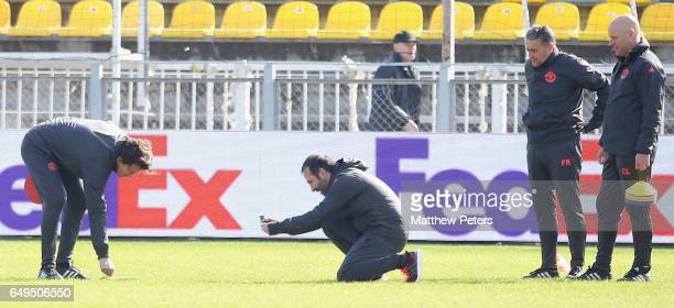 Assistant Manager Rui Faria and Coach Giovanni Cerra of Manchester United inspect the pitch during a first team training session at Olimp2 on March 8...