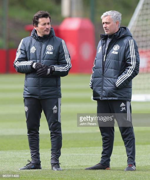 Assistant Manager Rui Faria and Manager Jose Mourinho of Manchester United in action during a first team training session at Aon Training Complex on...