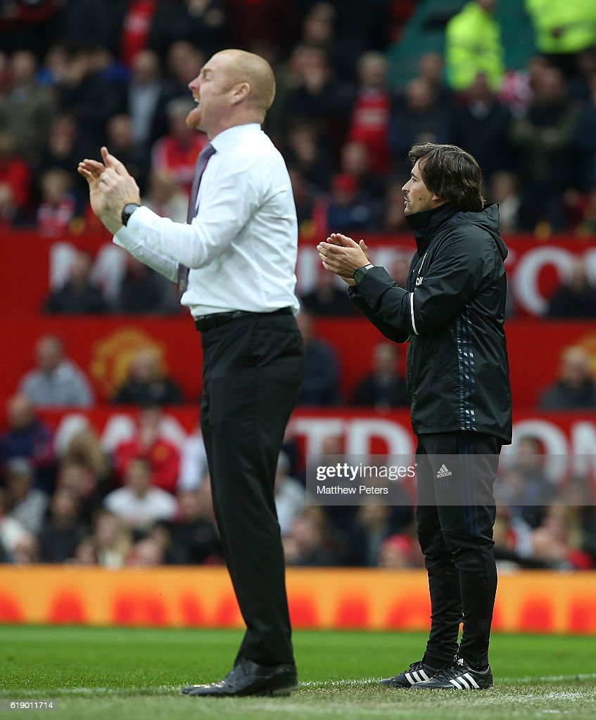 Assistant Manager Rui Faria of Manchester United and Manager Sean Dyche of Burnley watch from the touchline during the Premier League match between Manchester United and Burnley at Old Trafford on October 29, 2016 in Manchester, England.