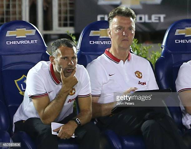 Assistant Manager Ryan Giggs and Manager Louis van Gaal of Manchester United watch frrom the bench during the preseason friendly match between LA...