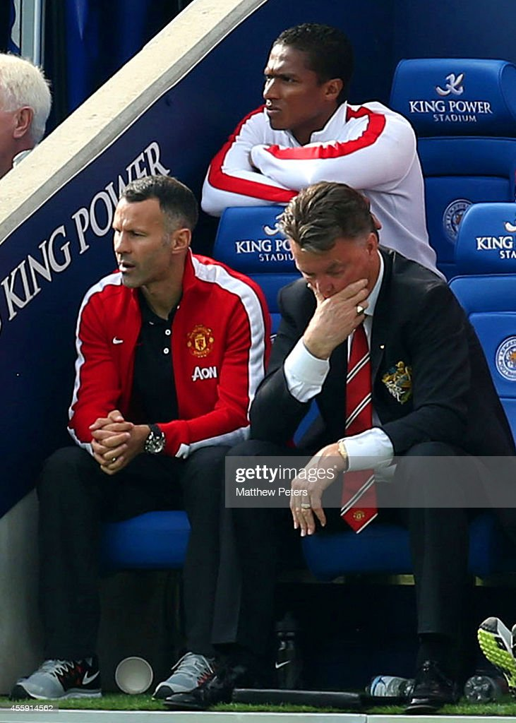 Assistant Manager Ryan Giggs and Manager Louis van Gaal of Manchester United show their disappointment during the Barclays Premier League match between Leicester City and Manchester United at The King Power Stadium on September 21, 2014 in Leicester, England.