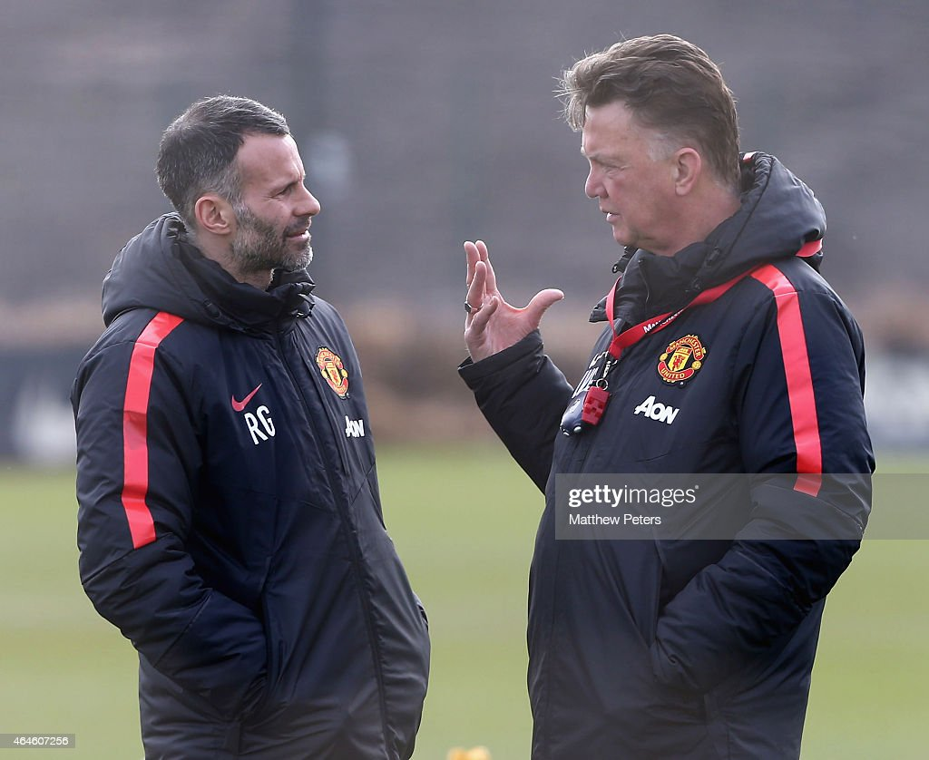 Assistant Manager Ryan Giggs and Manager Louis van Gaal of Manchester United in action during a first team training session at Aon Training Complex on February 27, 2015 in Manchester, England.