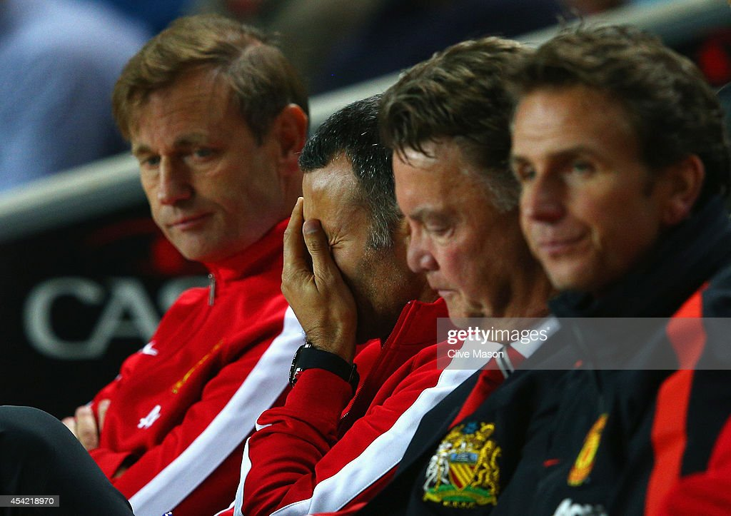 Assistant manager Ryan Giggs looks dejected with manager Louis van Gaal of Manchester United during the Capital One Cup Second Round match between MK Dons and Manchester United at Stadium mk on August 26, 2014 in Milton Keynes, England.
