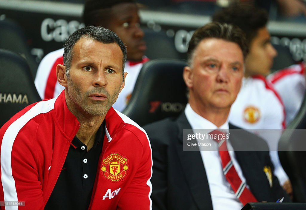 Assistant manager Ryan Giggs looks on with manager Louis van Gaal of Manchester United prior to the Capital One Cup Second Round match between MK Dons and Manchester United at Stadium mk on August 26, 2014 in Milton Keynes, England.