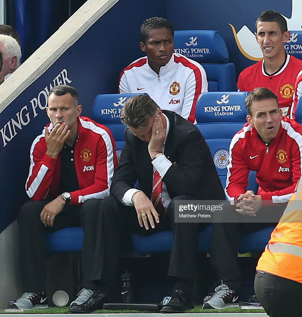 Assistant Manager Ryan Giggs, Manager Louis van Gaal and Assistant coach Albert Stuivenberg of Manchester United show their disappointment during the Barclays Premier League match between Leicester City and Manchester United at The King Power Stadium on September 21, 2014 in Leicester, England.