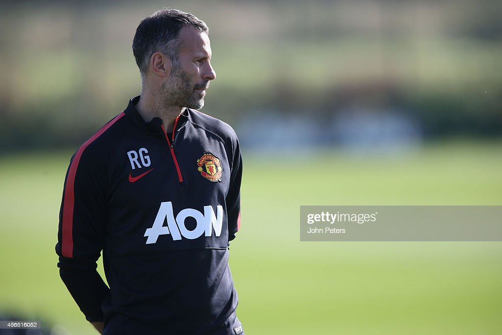 Assistant Manager Ryan Giggs of Manchester United in action during a first team training session at Aon Training Complex on October 2, 2014 in Manchester, England.