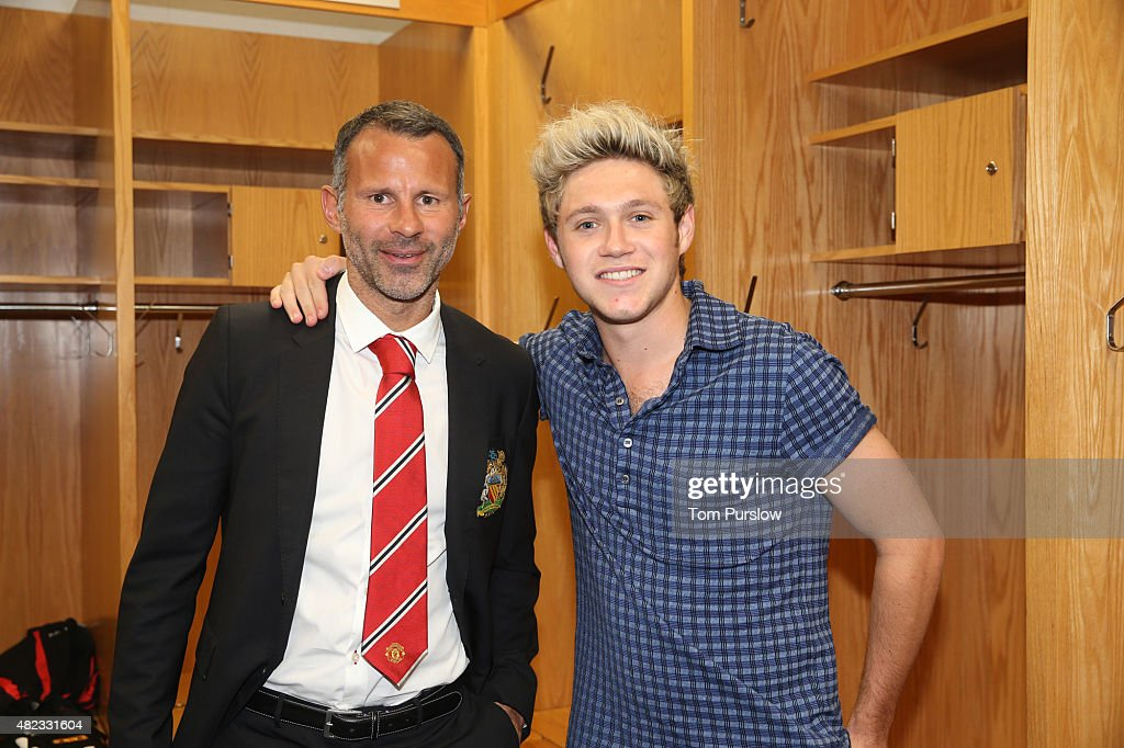 (MINIMUM PRINT/BROADCAST FEE OF GBP 150, ONLINE FEE OF GBP 50 PER IMAGE, OR LOCAL EQUIVALENT) Assistant Manager Ryan Giggs of Manchester United poses with Niall Horan of pop group One Direction after the International Champions Cup 2015 match between Manchester United and Paris Saint Germain at Soldier Field on July 29, 2015 in Chicago, Illinois.