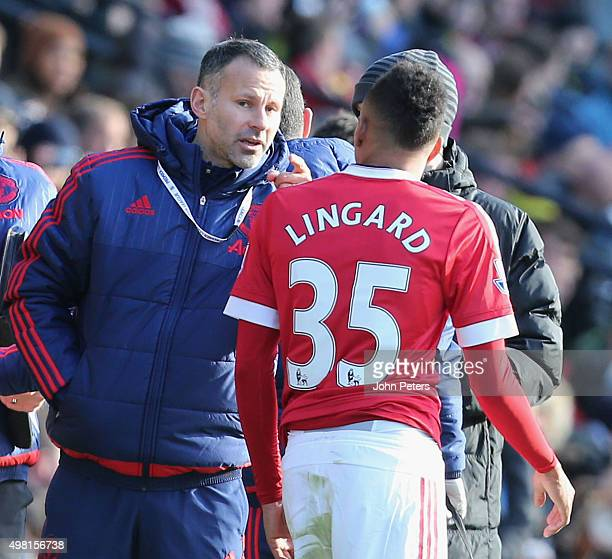Assistant Manager Ryan Giggs of Manchester United speaks to Jesse Lingard during the Barclays Premier League match between Watford and Manchester...