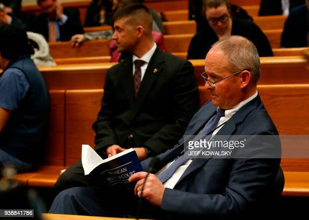 Assistant Michigan Attorney General Bill Rollstin attends the arraignment of Dr William Strampel the former dean of Michigan State University's...