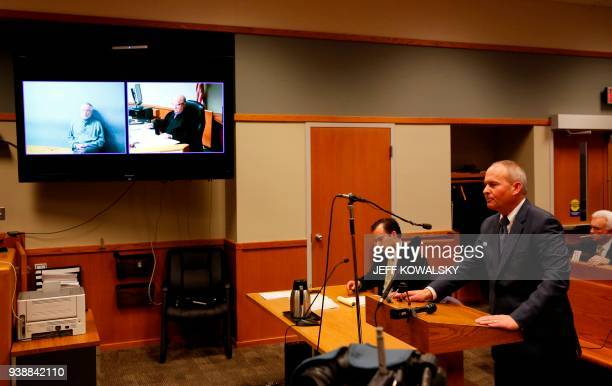 Assistant Michigan Attorney General Bill Rollstin speaks during the arraignment of Dr William Strampel the former dean of Michigan State University's...