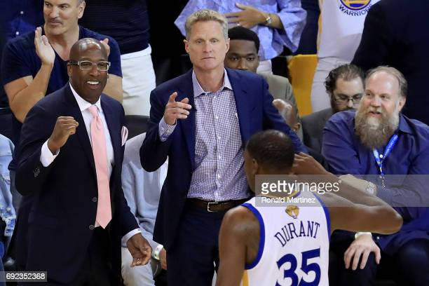 Assistant Mike Brown and head coach Steve Kerr of the Golden State Warriors react to a play against the Cleveland Cavaliers in Game 2 of the 2017 NBA...