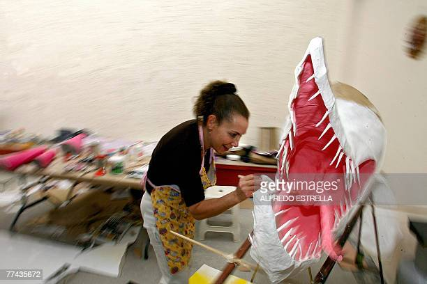 Assistant of Mexican craftswoman Elsa Linares Sandra Salguero works on an 'alebrije' called 'Head of Bird and Feet of Goat' in Mexico City for the...