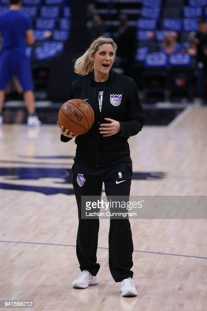 Assistant player development coach of the Sacramento Kings Jenny Boucek puts players through the warm up before their game against the Golden State...