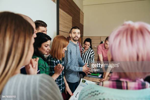 assistant professor debating with students - debate stock photos and pictures