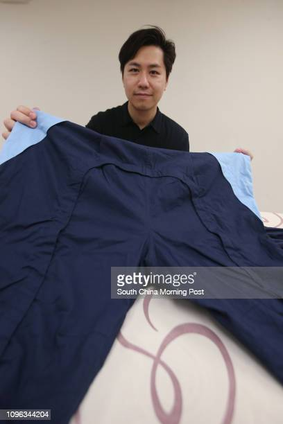 Assistant Professor Dr Ho Chupo of Polytechnic University displays a pair of antistrip overalls Tung Wah Group of Hospitals and Polytechnic...