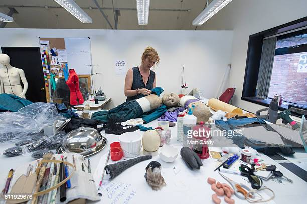 Assistant puppet costume maker Dulcie Best dresses a puppet that will be appearing in the forthcoming production of The Grinning Man at the Bristol...