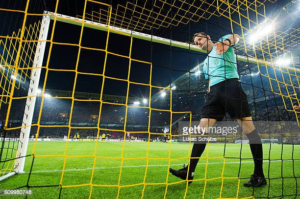 Assistant referee Arne Aarnink checkes the goal net prior to the Bundesliga match between Borussia Dortmund and SC Freiburg at Signal Iduna Park on...