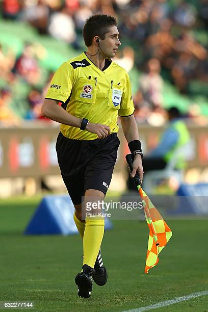 Assistant referee Ashley Beecham runs the sideline during the round 16 ALeague match between Perth Glory and Melbourne Victory at nib Stadium on...