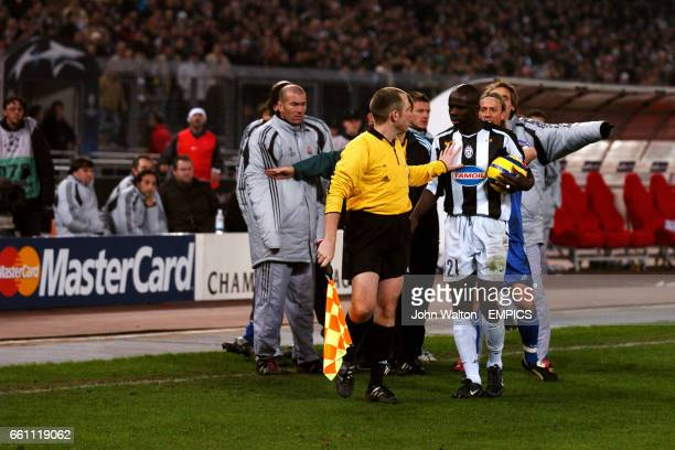 Assistant referee Christian Schraer holds off Juventus' Lilian Thuram prior to the sending off of Juventus' Alessio Tacchinardi and Real Madrid's...