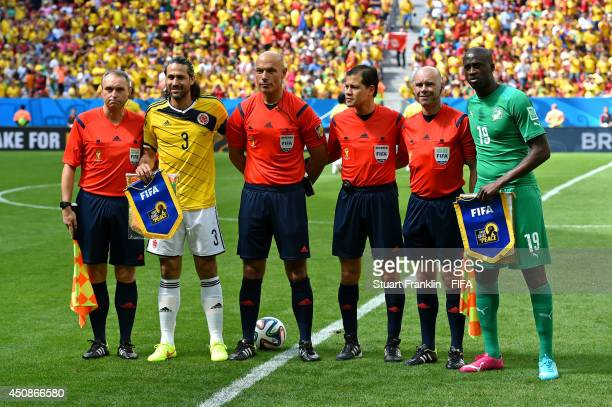 Assistant referee Darren Cann Mario Yepes of Colombia referee Howard Webb fourth official Victor Carrillo assistant referee Michael Mullarkey and...