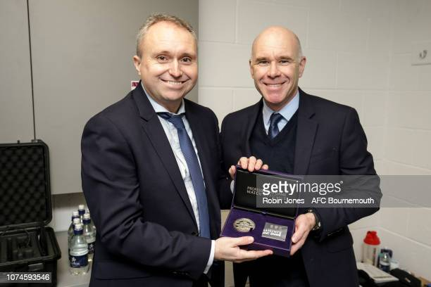 Assistant referee Darren Cann who was officiating his 400th game today was presented with a commemorative medal by Mike Mullarkey before the Premier...