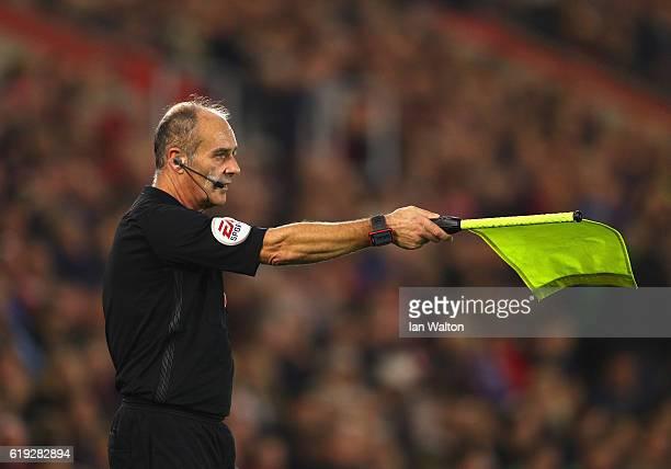 Assistant referee Dave Bryan holds the offside flag up during the Premier League match between Southampton and Chelsea at St Mary's Stadium on...
