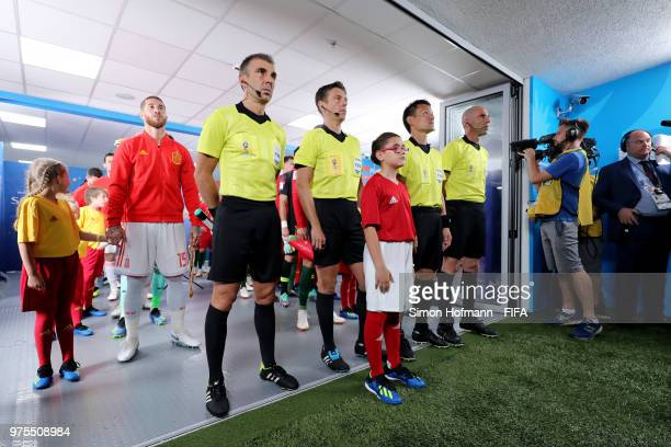 Assistant referee Elenito Di Liberatore Referee Gianluca Rocchi assistant referee Ryuji Sato and assistant referee Mauro Tonolini wait to make their...