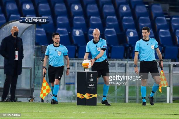 Assistant referee Gary Beswick, referee Anthony Taylor and assistant referee Adam Nunn during the UEFA Europa League Quarter Final: Leg Two match...