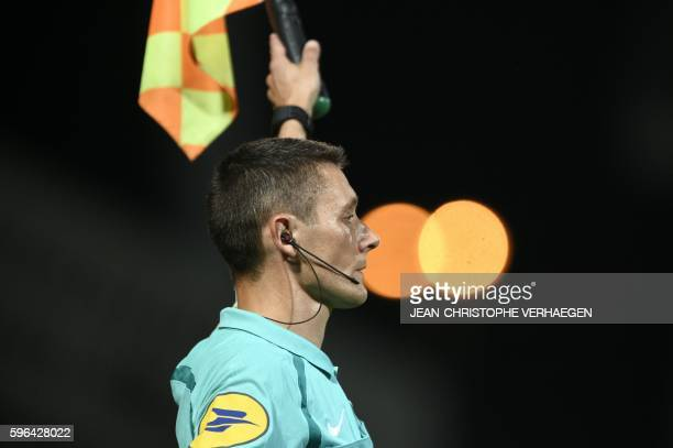 Assistant referee Gilles Lang gestures during the French L1 football match between Metz and Angers on August 27 2016 at the Saint Symphorien stadium...