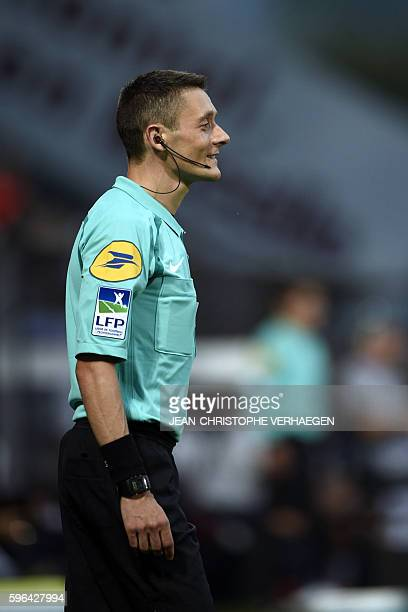 Assistant referee Gilles Lang smiles during the French L1 football match between Metz and Angers on August 27 2016 at the Saint Symphorien stadium in...