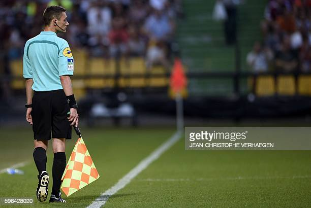 Assistant referee Gilles Lang walks during the French L1 football match between Metz and Angers on August 27 2016 at the Saint Symphorien stadium in...