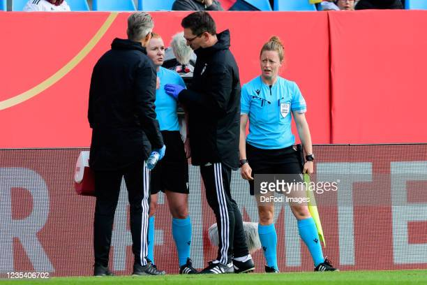 Assistant referee Helen Edwards receives medical treatment during the FIFA Women's World Cup 2023 Qualifier group H match between Germany and Serbia...