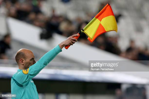 Assistant referee holds the offside flag during a French cup match between Bordeaux and Lorient at Stade Matmut Atlantique on February 28 2017 in...
