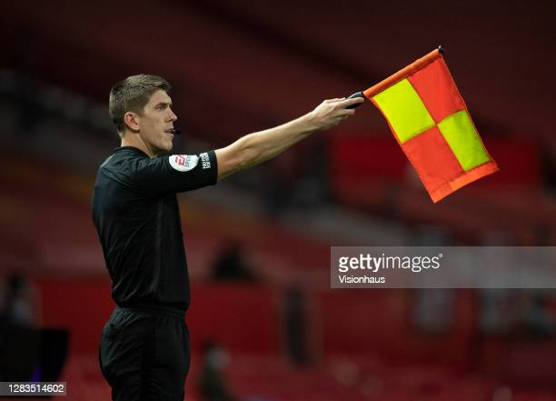 Assistant referee Ian Hussin holds his flag up for an offside decision during the Premier League match between Manchester United and Arsenal at Old...