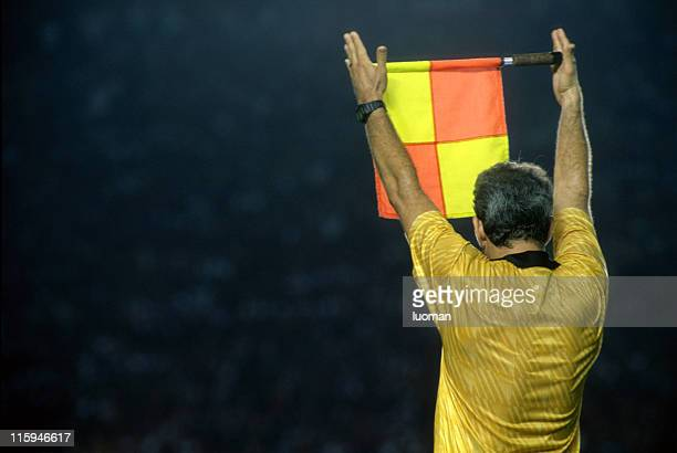 assistant referee informing a substitution - referee stock photos and pictures