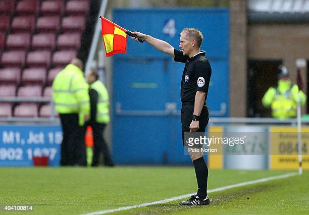 Assistant Referee John Law raises his flag for offside during the Sky Bet League Two match between Northampton Tpwn and Stevenage at Sixfields...