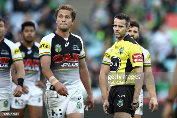 Assistant referee Jon Stone watches on during the round 17 NRL match between the South Sydney Rabbitohs and the Penrith Panthers at ANZ Stadium on...