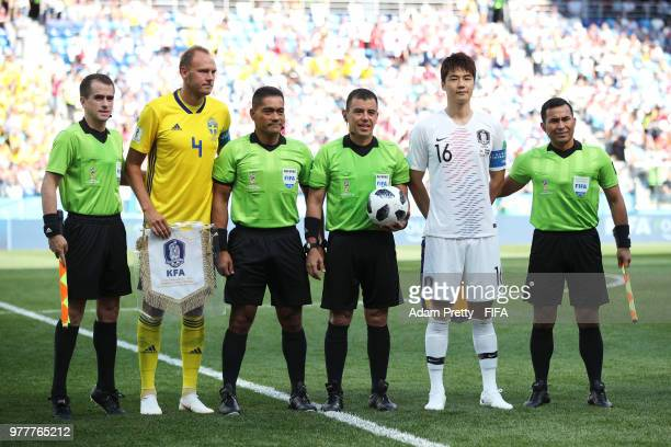 Assistant referee Juan Zumba Andreas Granqvist of Sweden fourth official Norbert Hauata referee Joel Aguilar Ki SungYueng and assistant referee Juan...