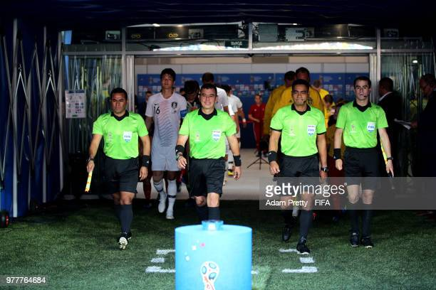 Assistant referee Juan Zumba referee Joel Aguilar assistant referee Juan Carlos Mora Araya and fourth official Norbert Hauata walk on the pitch prior...