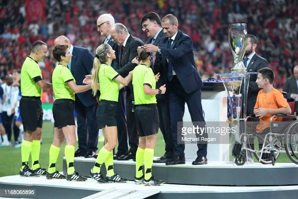 Assistant referee Manuela Nicolosi fourth official Cüneyt Çakır match referee Stephanie Frappart and assistant referee Michelle O Neill are presented...