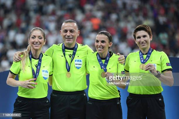 Assistant referee Manuela Nicolosi fourth official Cüneyt Çakır match referee Stephanie Frappart and assistant referee Michelle O Neill pose with...