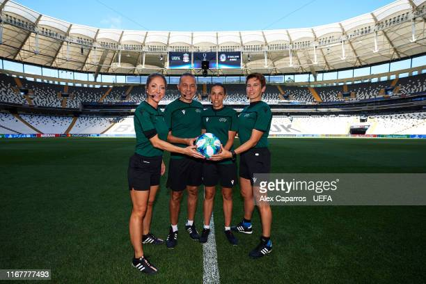 Assistant referee Manuela Nicolosi of France fourth official Cuneyt Cakir of Turkey main referee Stephanie Frappart of France and assistant referee...