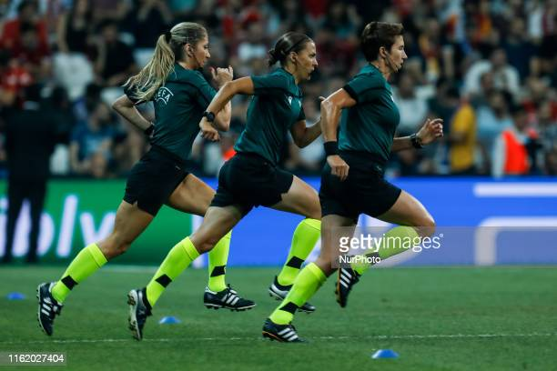 Assistant referee Manuela Nicolosi referee Stephanie Frappart assistant referee Michelle O'Neill during the warmup ahead of the UEFA Super Cup match...