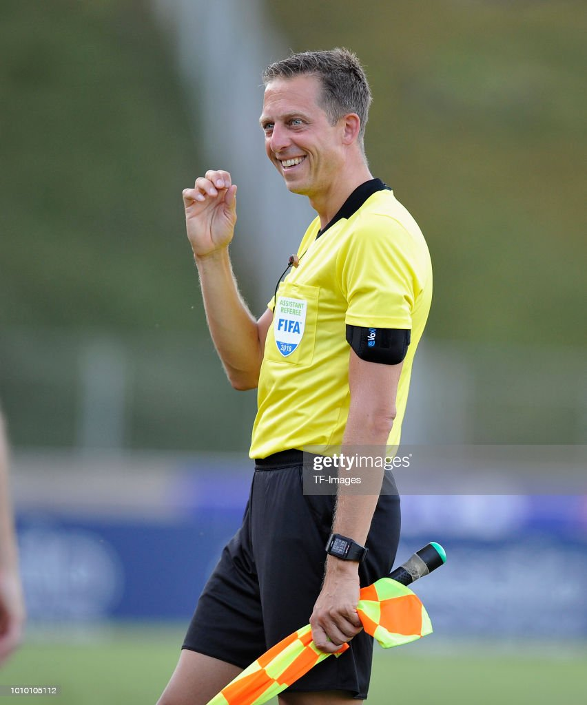Assistant referee Mark Borsch laughs during the pre-season friendly match between 1. FC Koeln and 1. FSV Mainz 05 at Sportpark Nord on July 27, 2018 in Bonn, Germany.