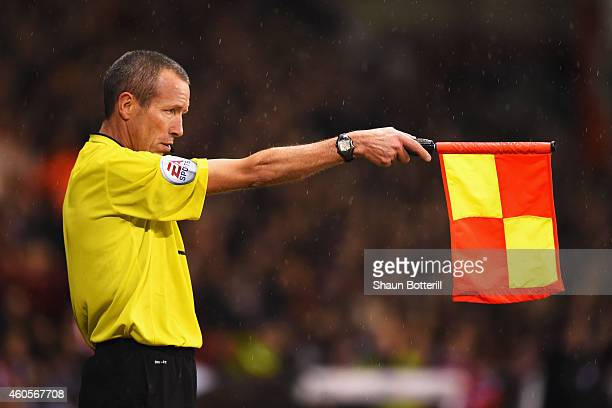 Assistant referee Michael McDonough flags for offside during the Capital One Cup QuarterFinal match between Sheffield United and Southampton at...
